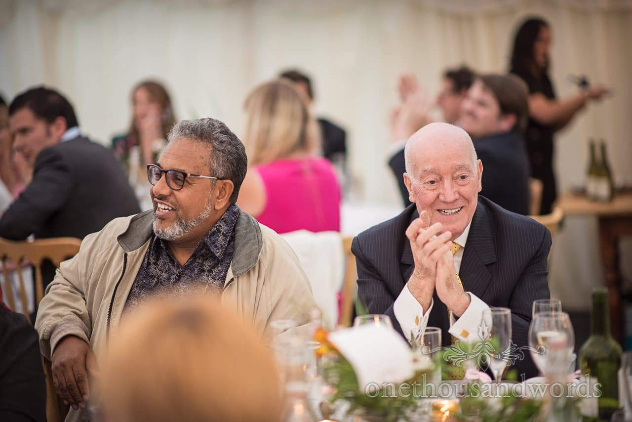 Guest reaction during marquee wedding reception