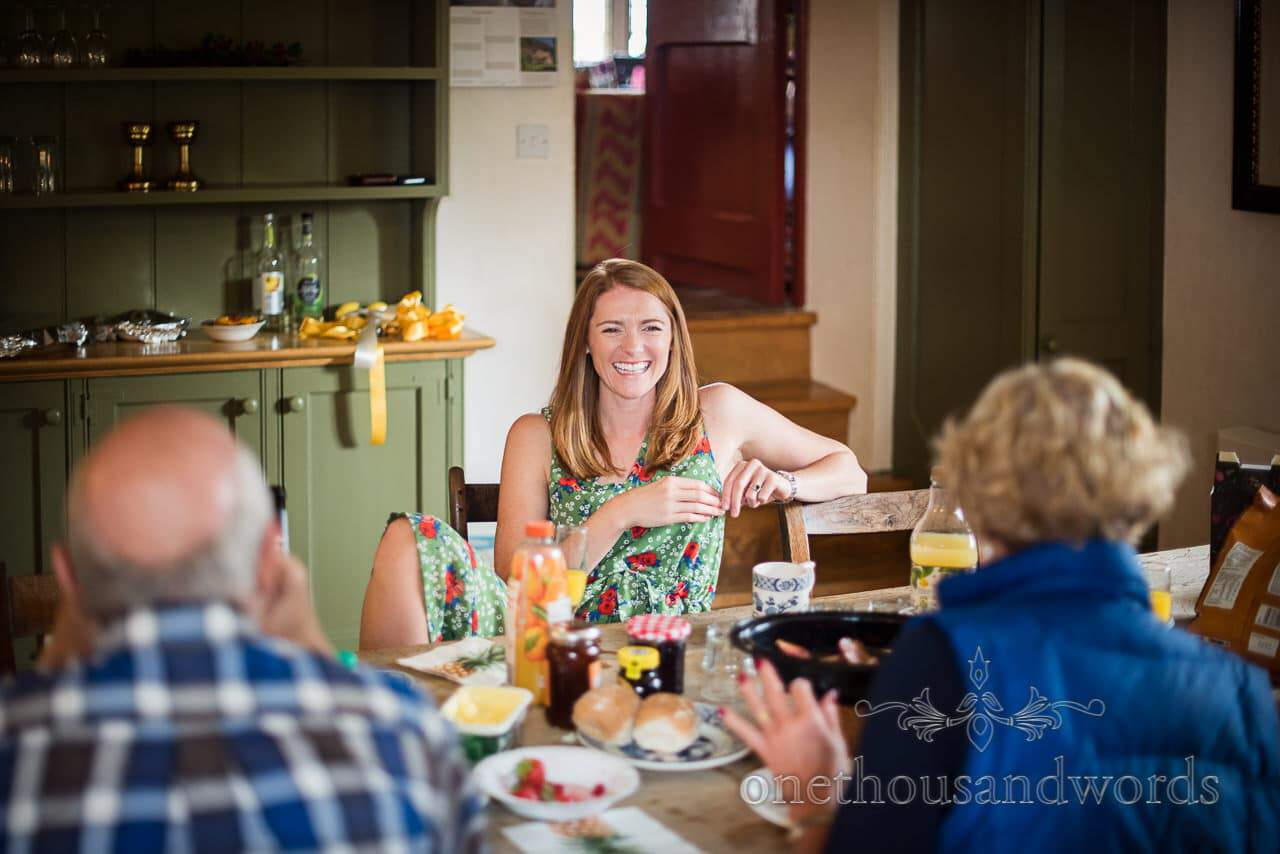 Guest relaxing ion kitchen at Woodsford castle before Garden Wedding