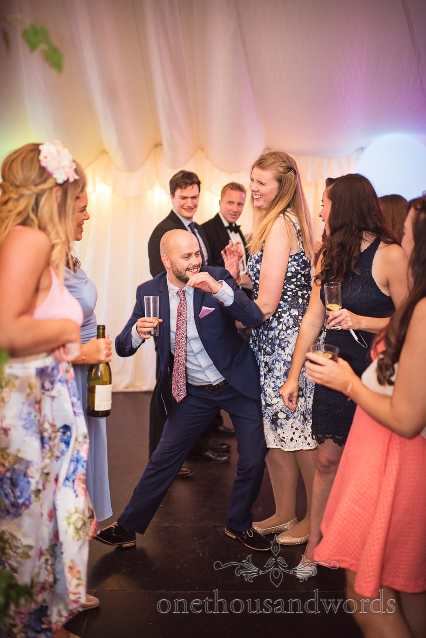 Guest throws some serious shapes on dance floor during evening reception