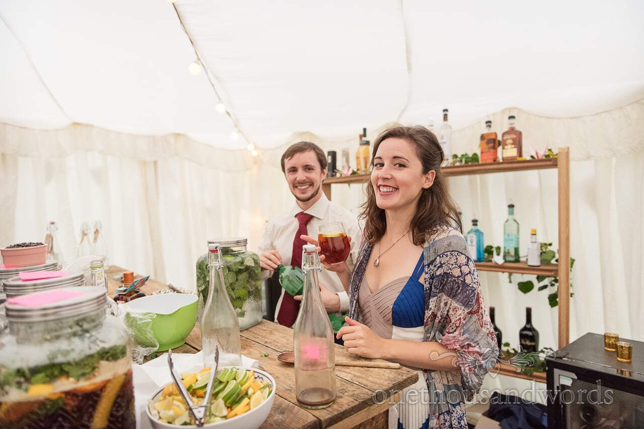 Guests at the marquee bar at Dorset garden wedding