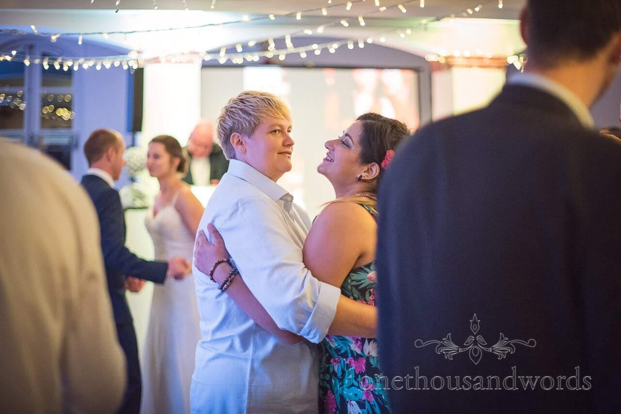 Guests dance during evening reception at Italian Villa Wedding