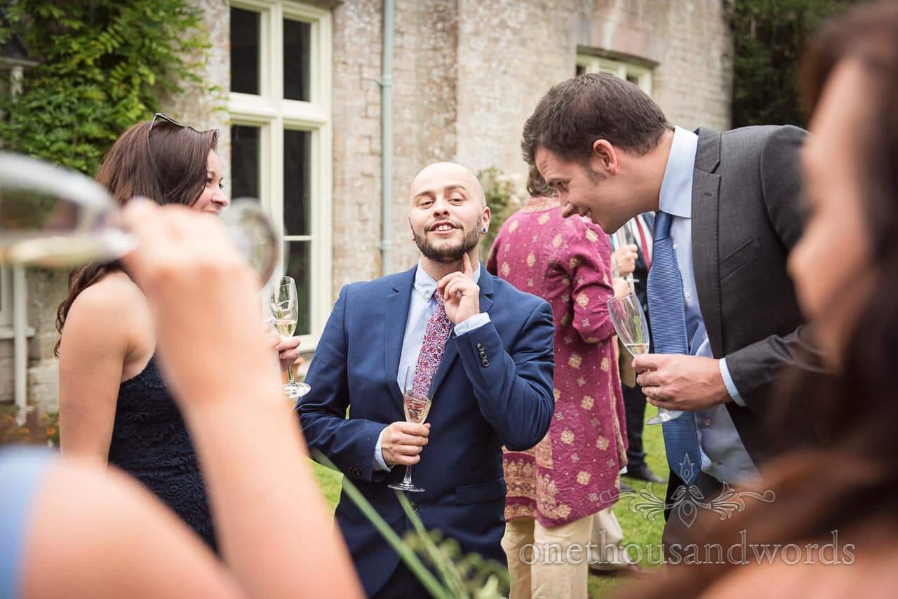 Guests enjoy drinks reception at Dorset garden wedding