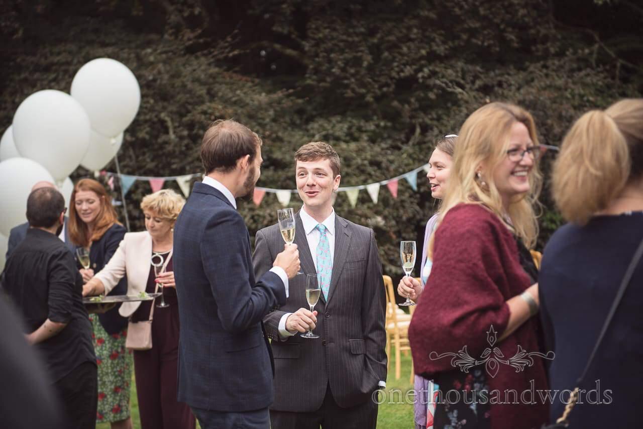 Guests enjoy drinks reception at Garden wedding