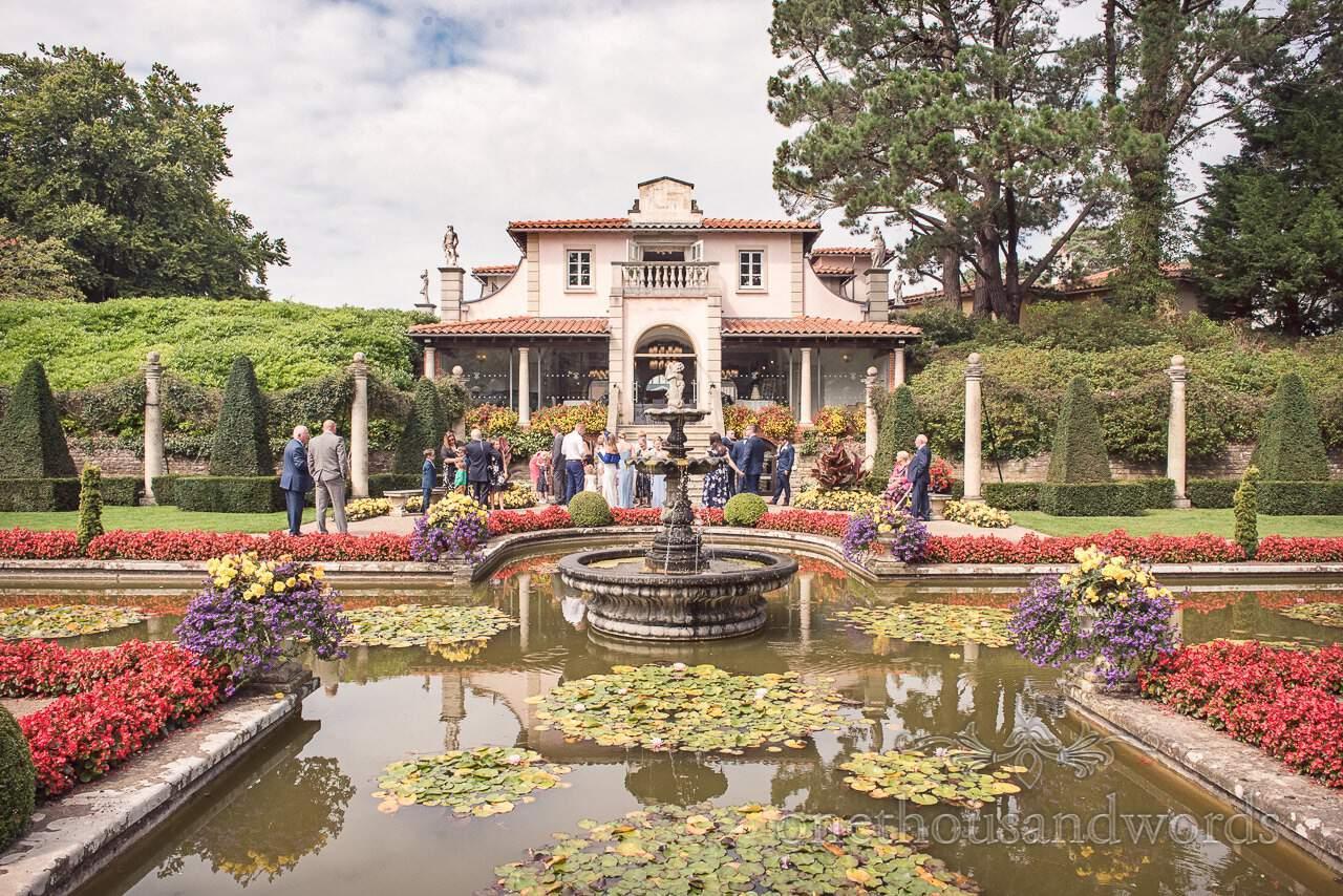 Guests gather in garden at the Italian Villa Wedding venue Photos