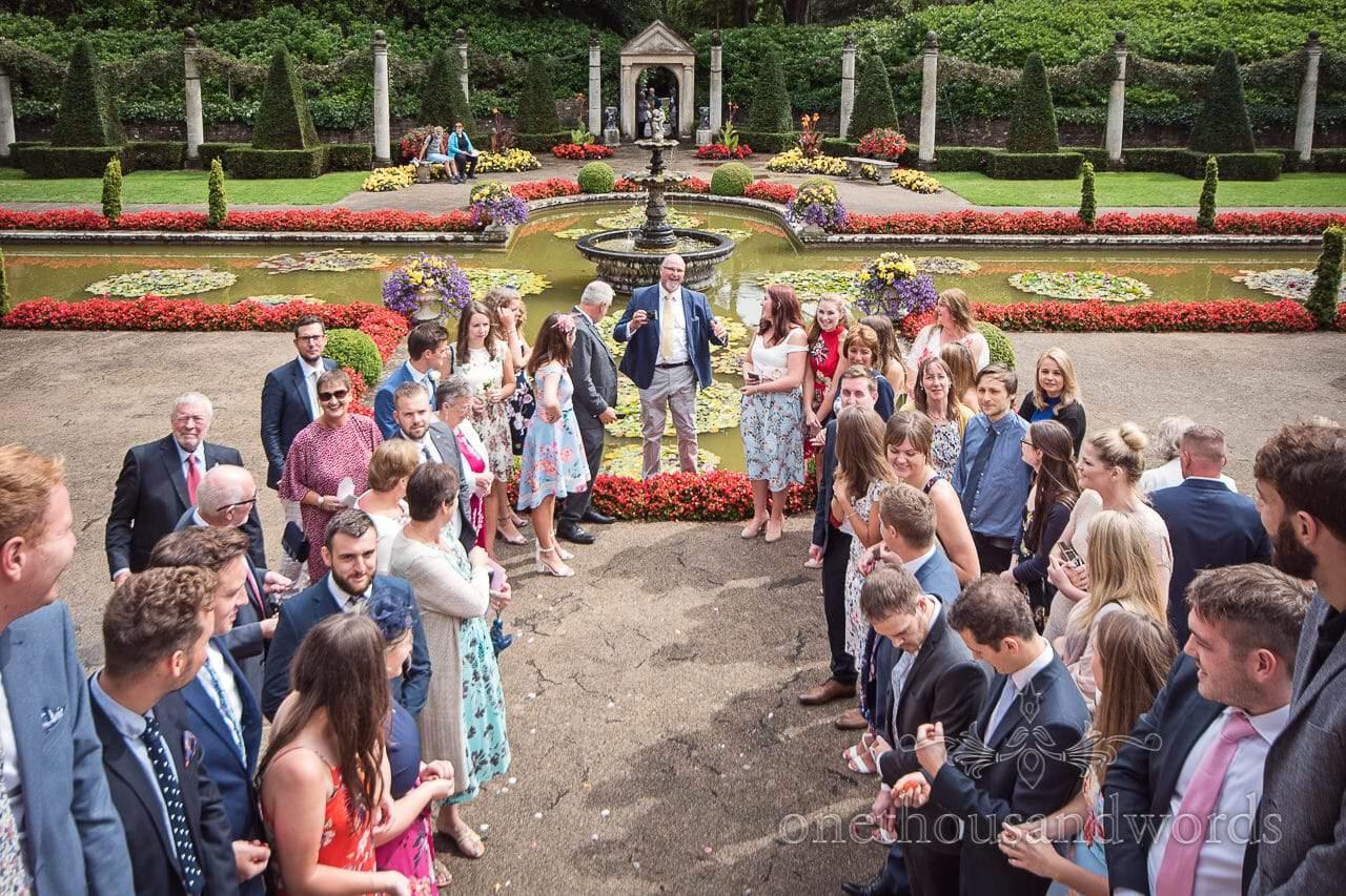 Guests gather in garden at the Italian Villa Wedding Venue