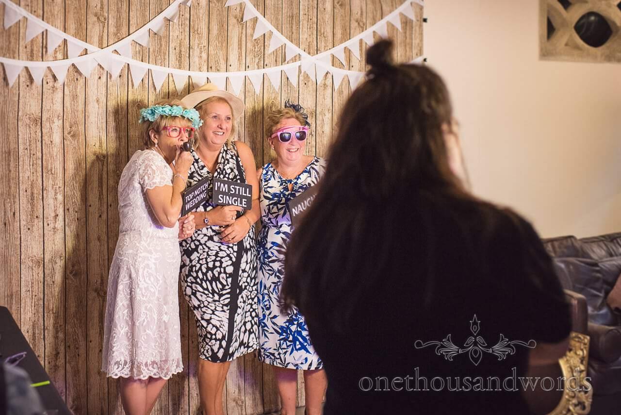 Guests in wedding photo booth at Italian Villa Wedding