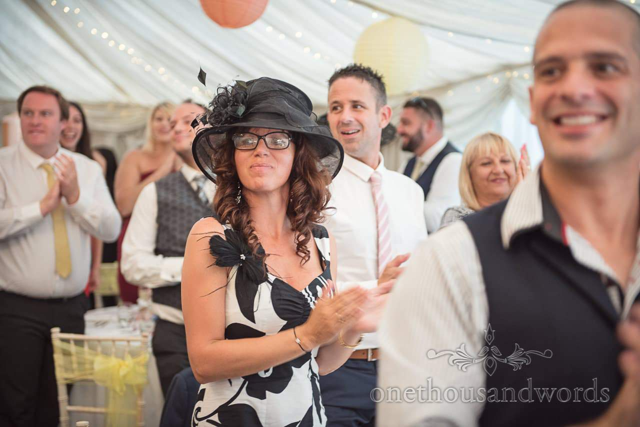 Guests welcome newlyweds in to marquee at The Old Vicarage Wedding