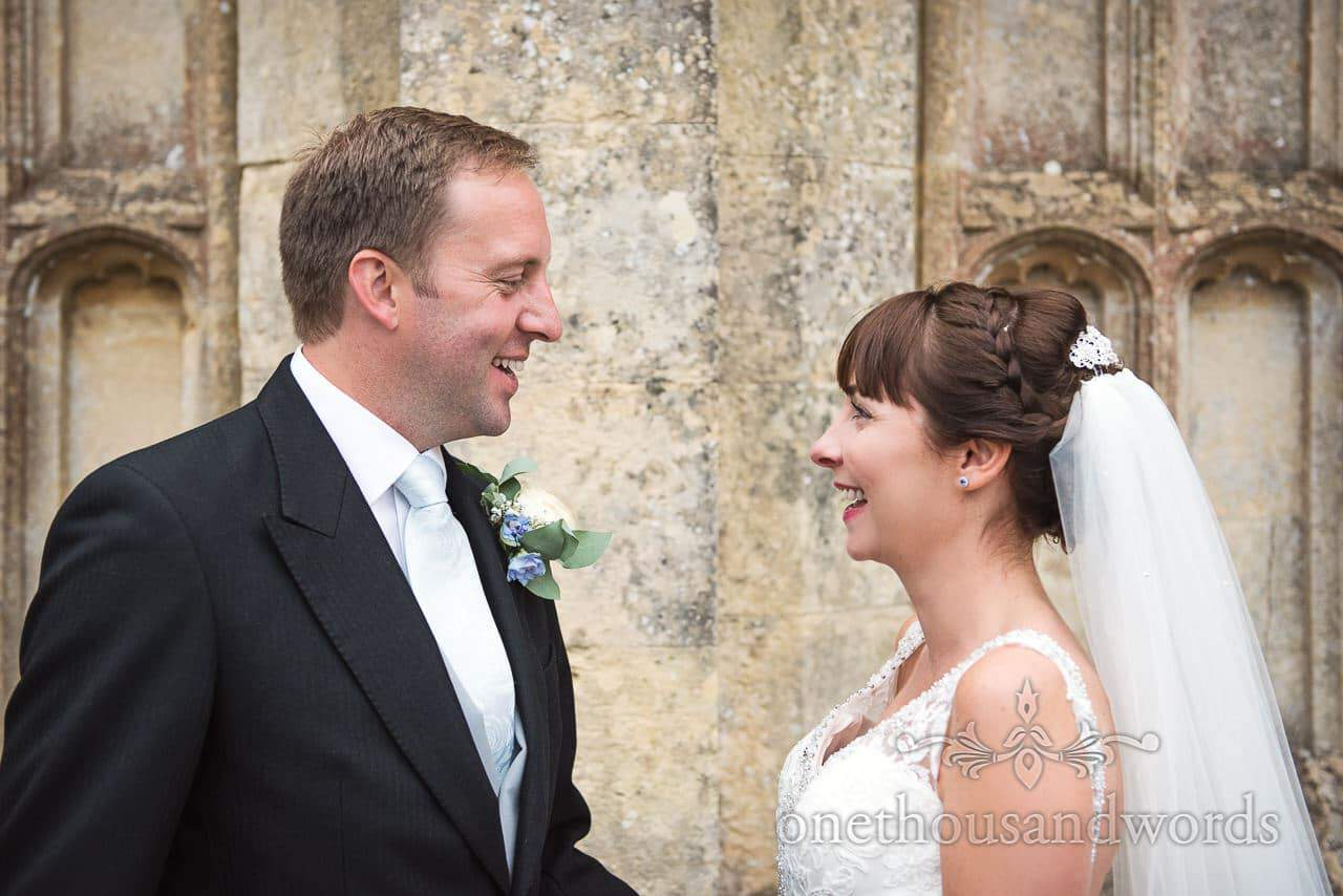 Happy bride and groom in grounds during Canford School Wedding Photographs