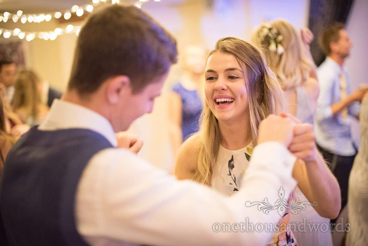 Happy wedding guests dancing at Italian Villa wedding reception evening
