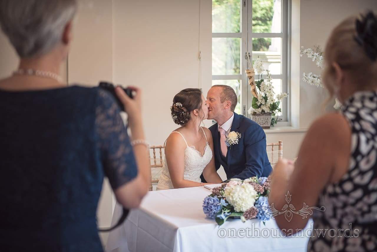 Kissing bride and groom after civil ceremony at Italian Villa Wedding Venue Photos