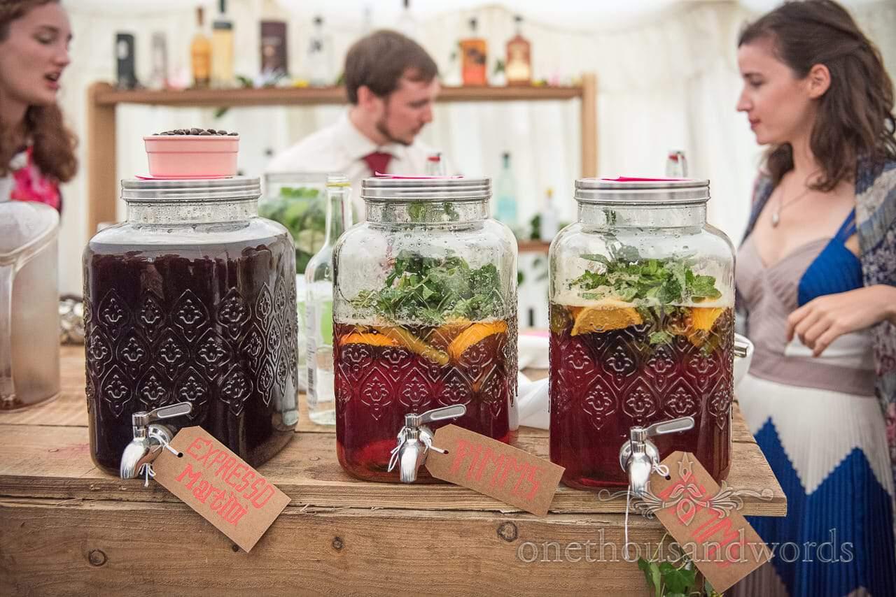 Large glass drinks dispensers at Dorset garden wedding
