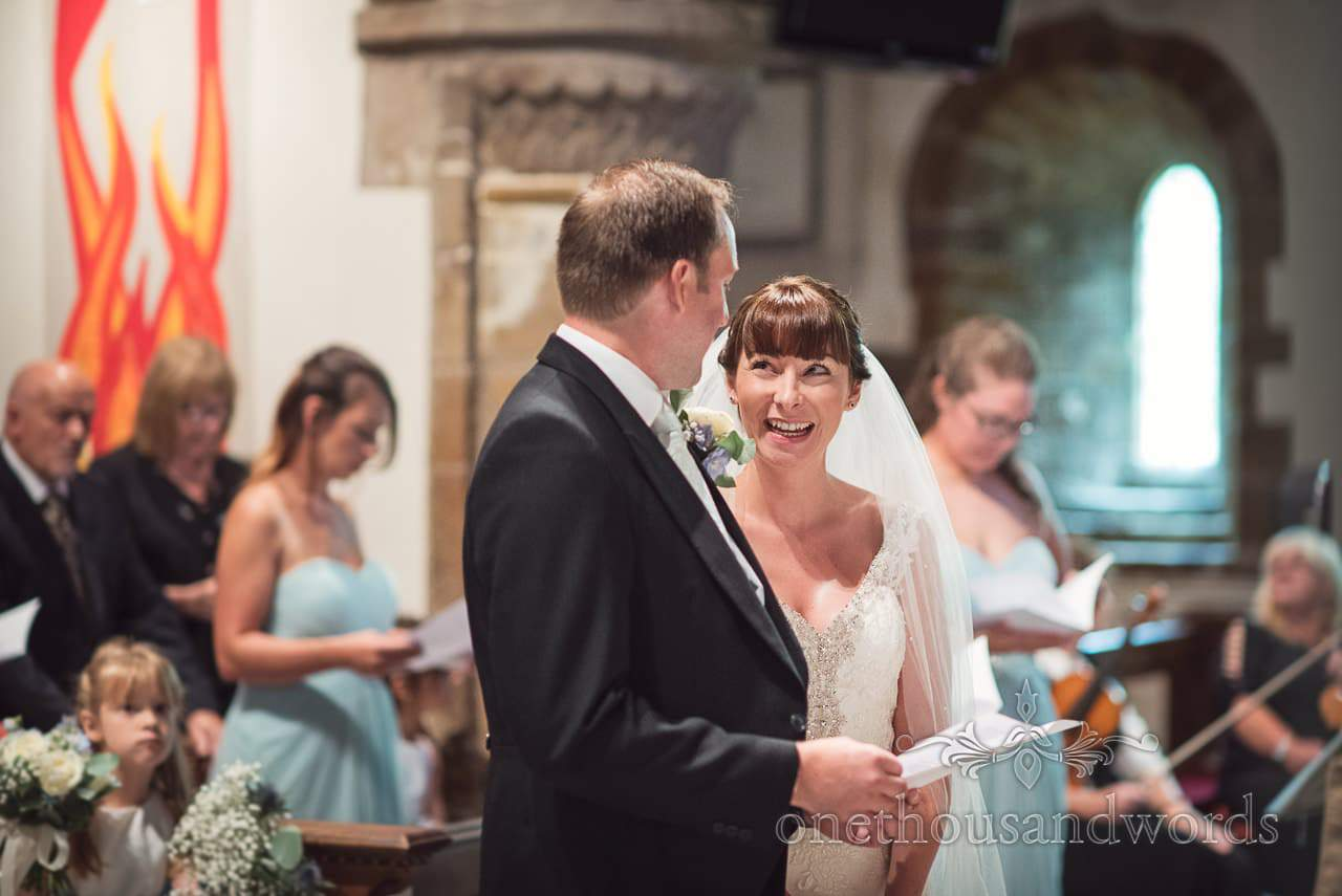 Laughing bride during church wedding at Canford School