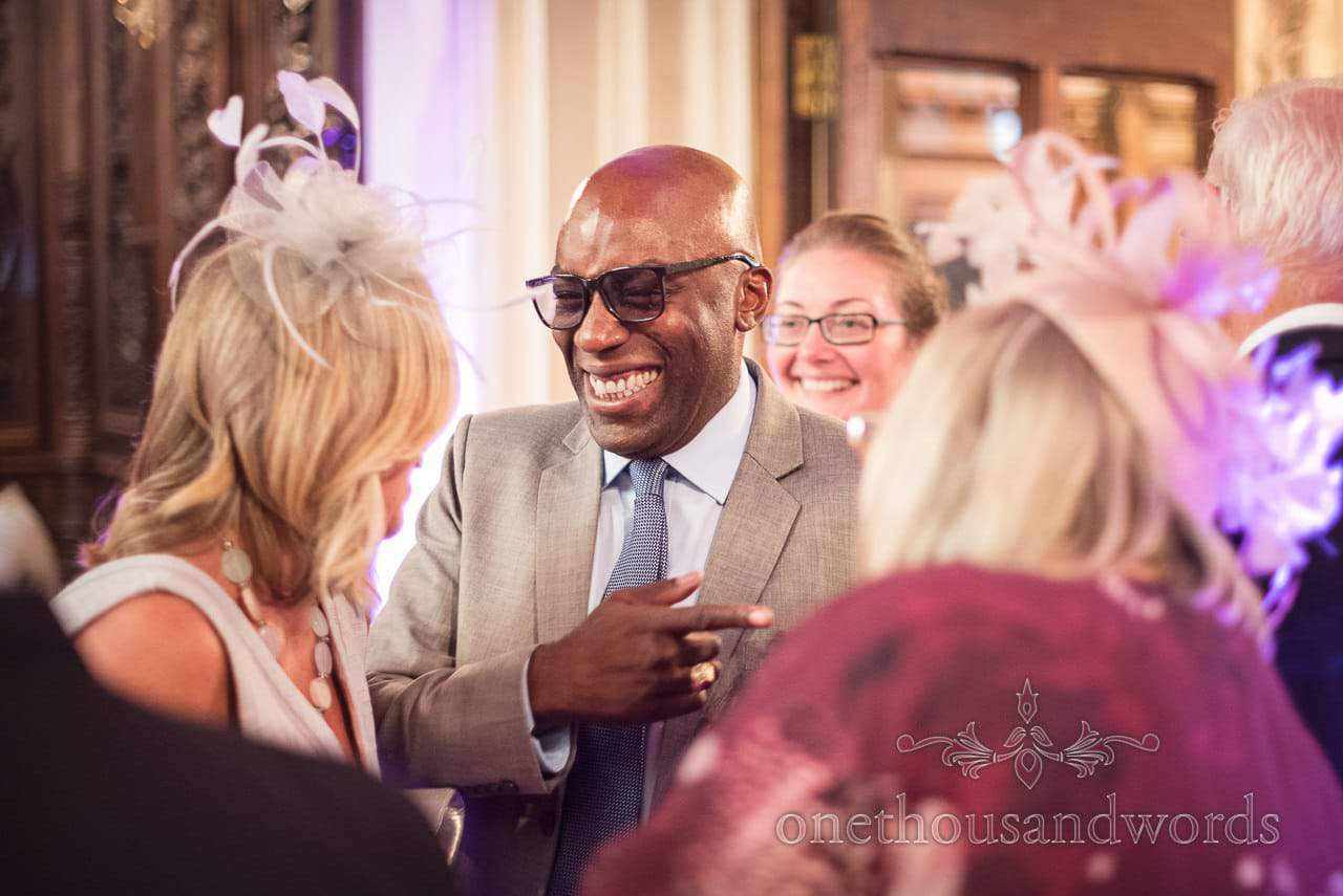 Laughing guest during receiving line at Canford School Wedding