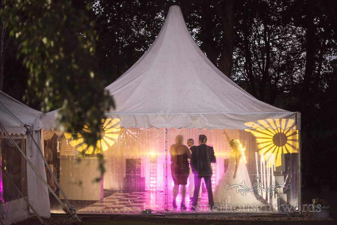 Marque is lit up with disco lights at the Old Vicarage Wedding