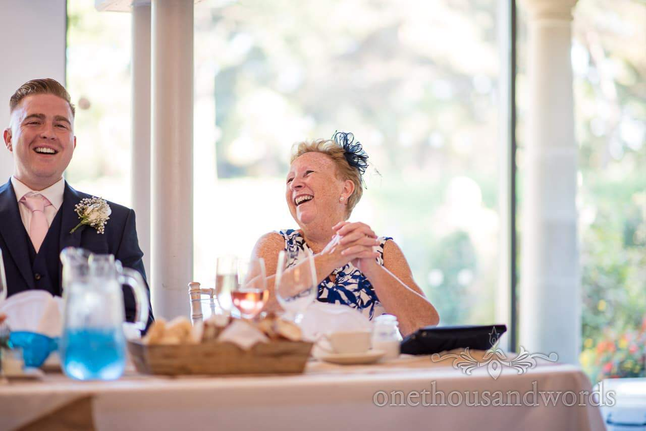Mother of the groom and best man laugh during speech at Italian Villa Wedding