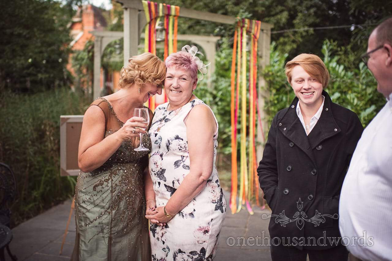 Mother of the bride and guest share a joke at Old Vicarage Wedding