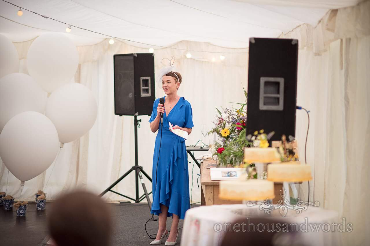 Mother of the bride delivers speech during garden marquee reception
