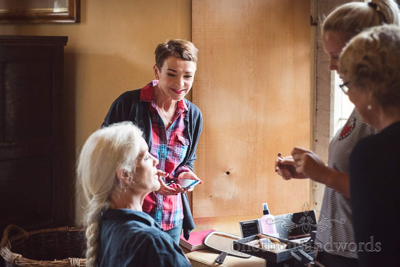 Mothers have make up styled during wedding morning at Woodsford castle