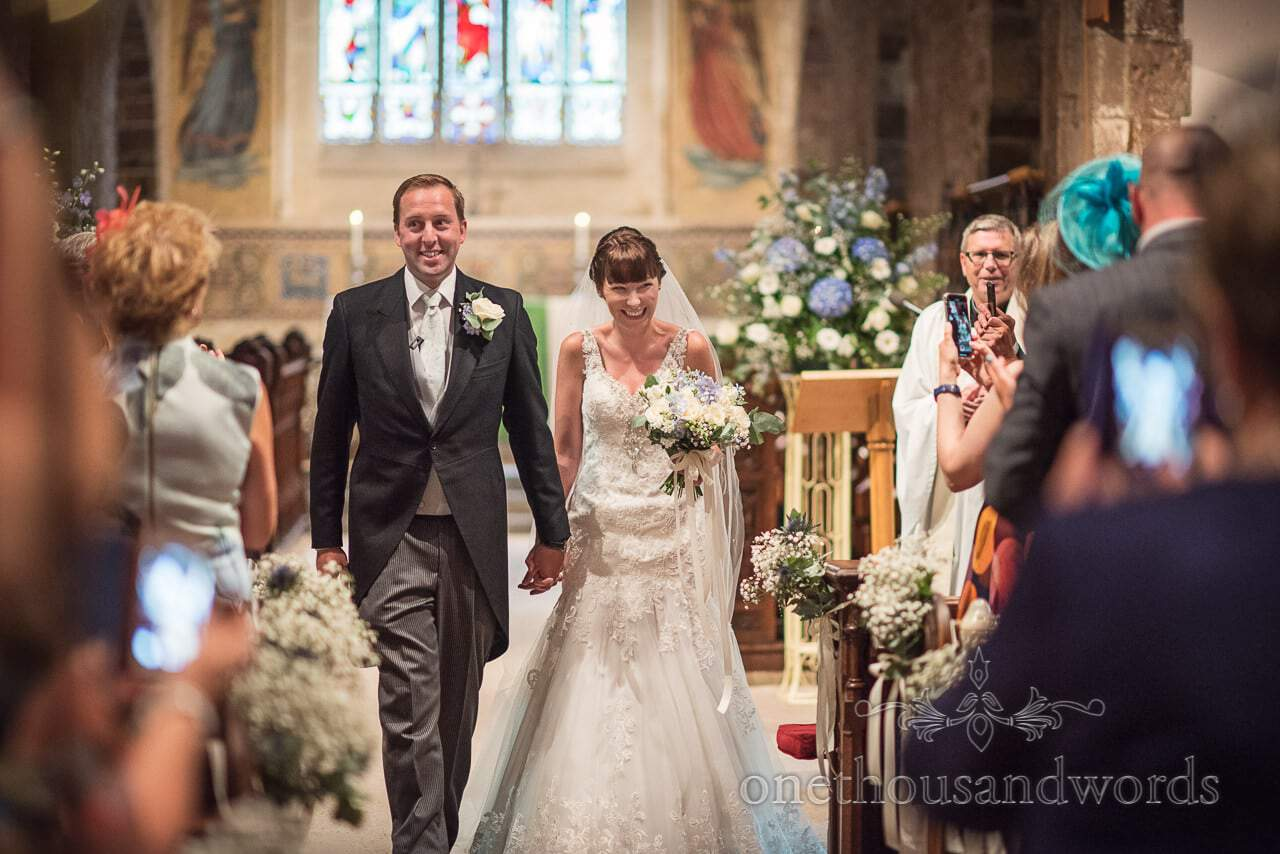 New Mr and Mrs come down the aisle in Norman church Wedding