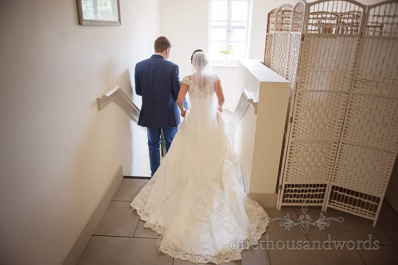 Newlyweds descend the stairs after ceremony at Italian Villa Wedding venue