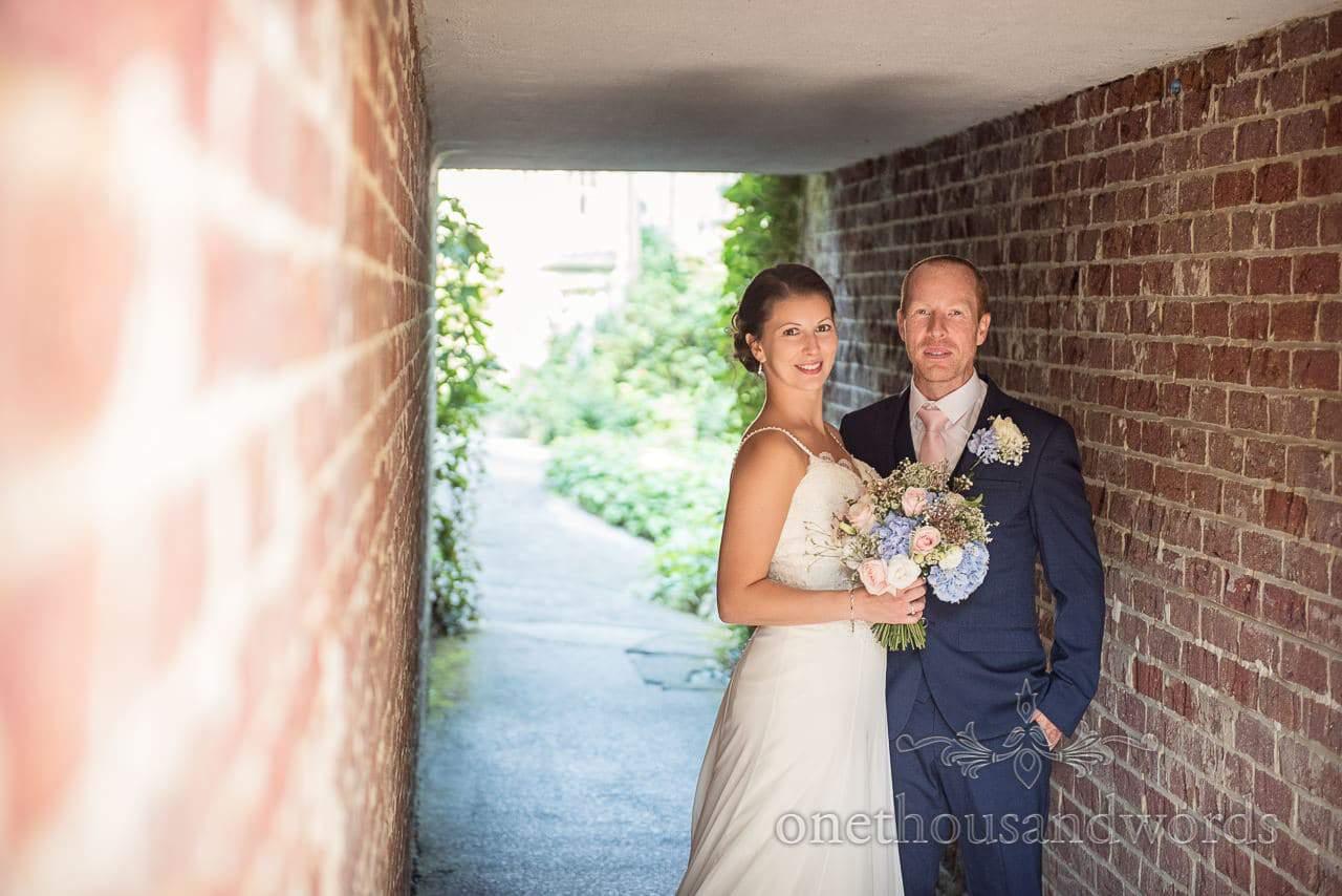 Newlyweds in garden tunnel at the Italian Villa Wedding