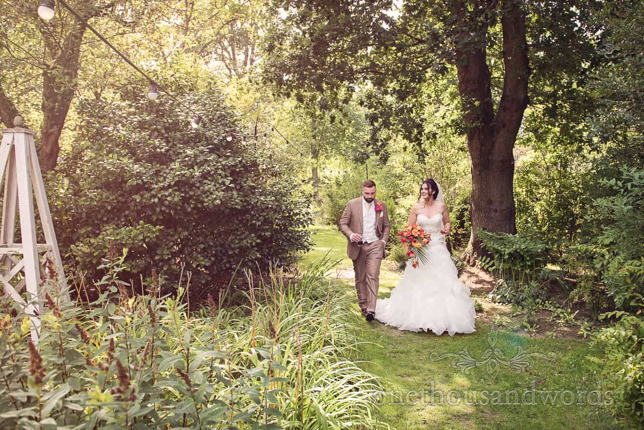 Newlyweds take a stroll in the garden at The Old Vicarage Wedding Photographs