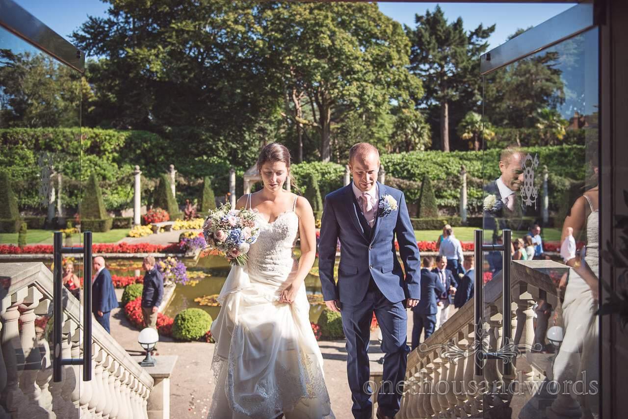 Newlyweds walk up the steps to reception at Italian Villa Wedding