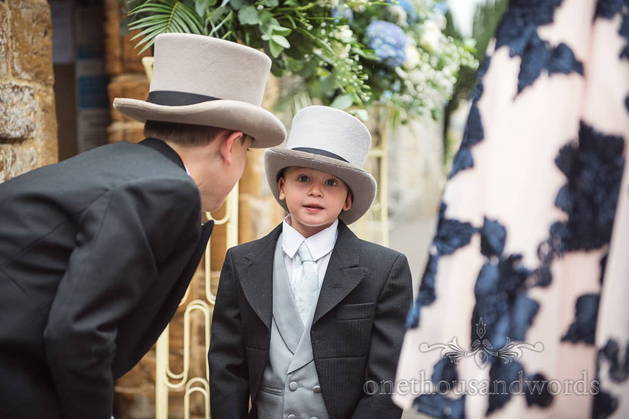Smart young page boys in top hats at Canford School Wedding