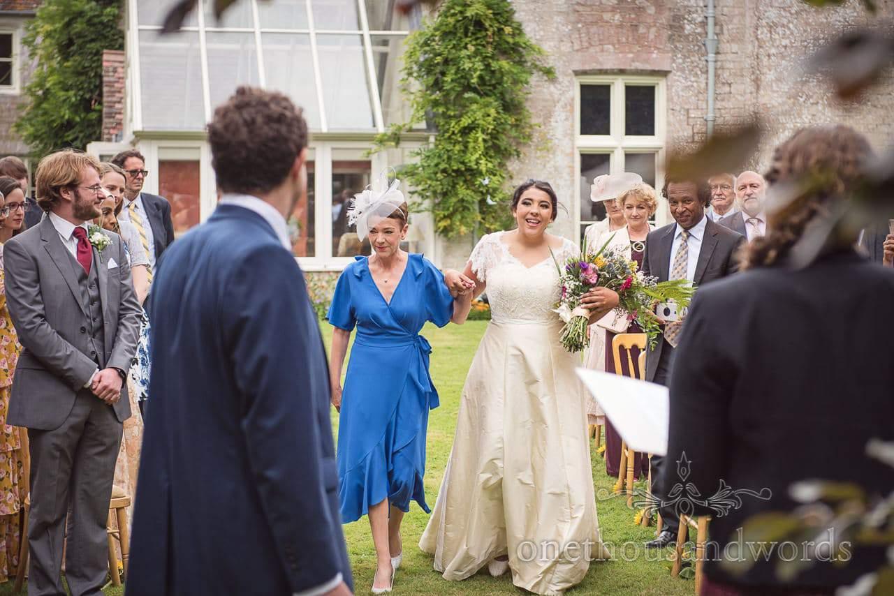 Smiling bride arrives for Dorset garden wedding ceremony