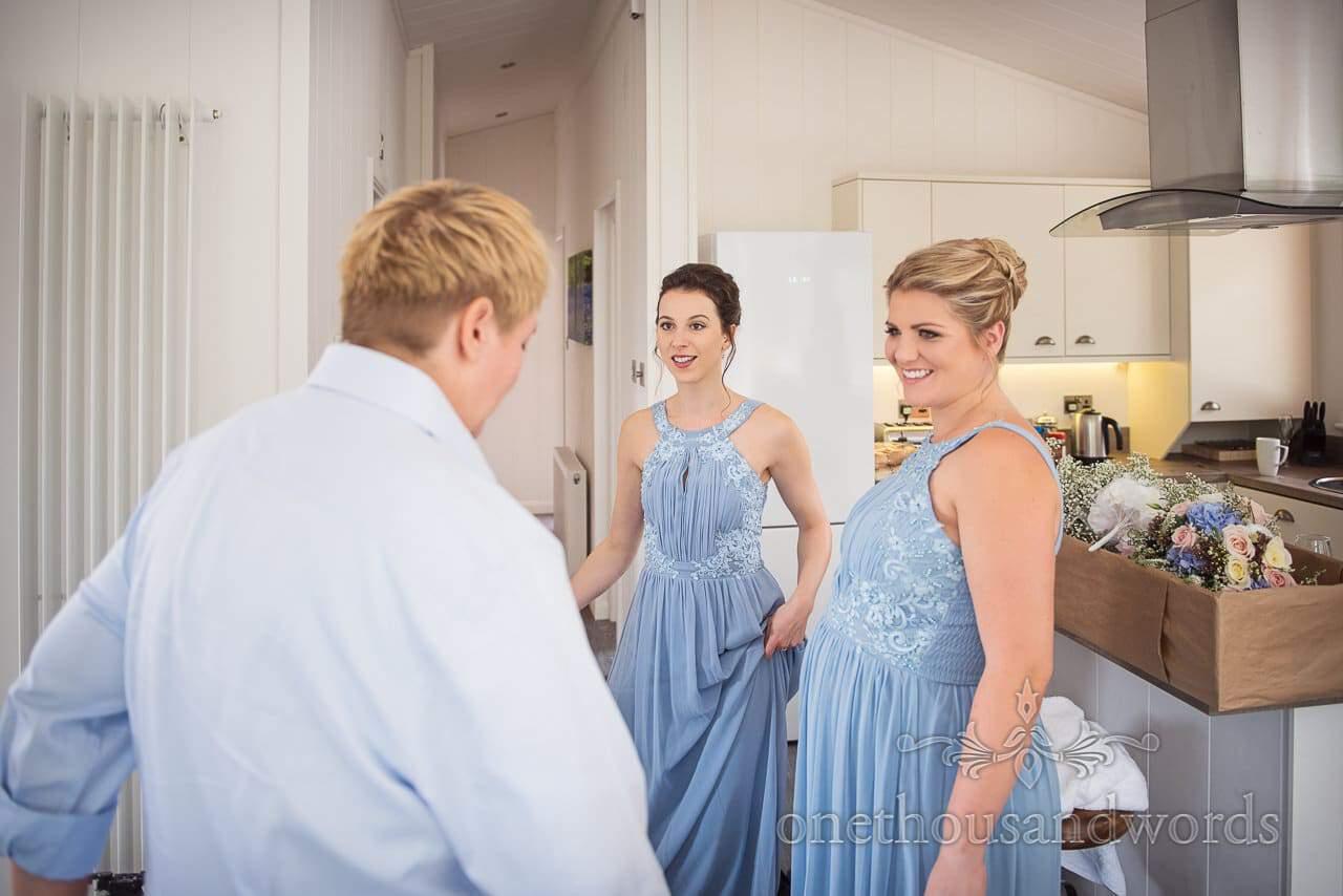 Smiling bridesmaids in blue on morning of Italian villa wedding