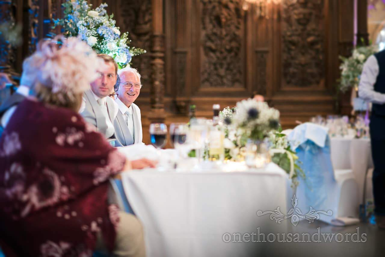 Smiling father of the groom during speeches at Canford School Wedding