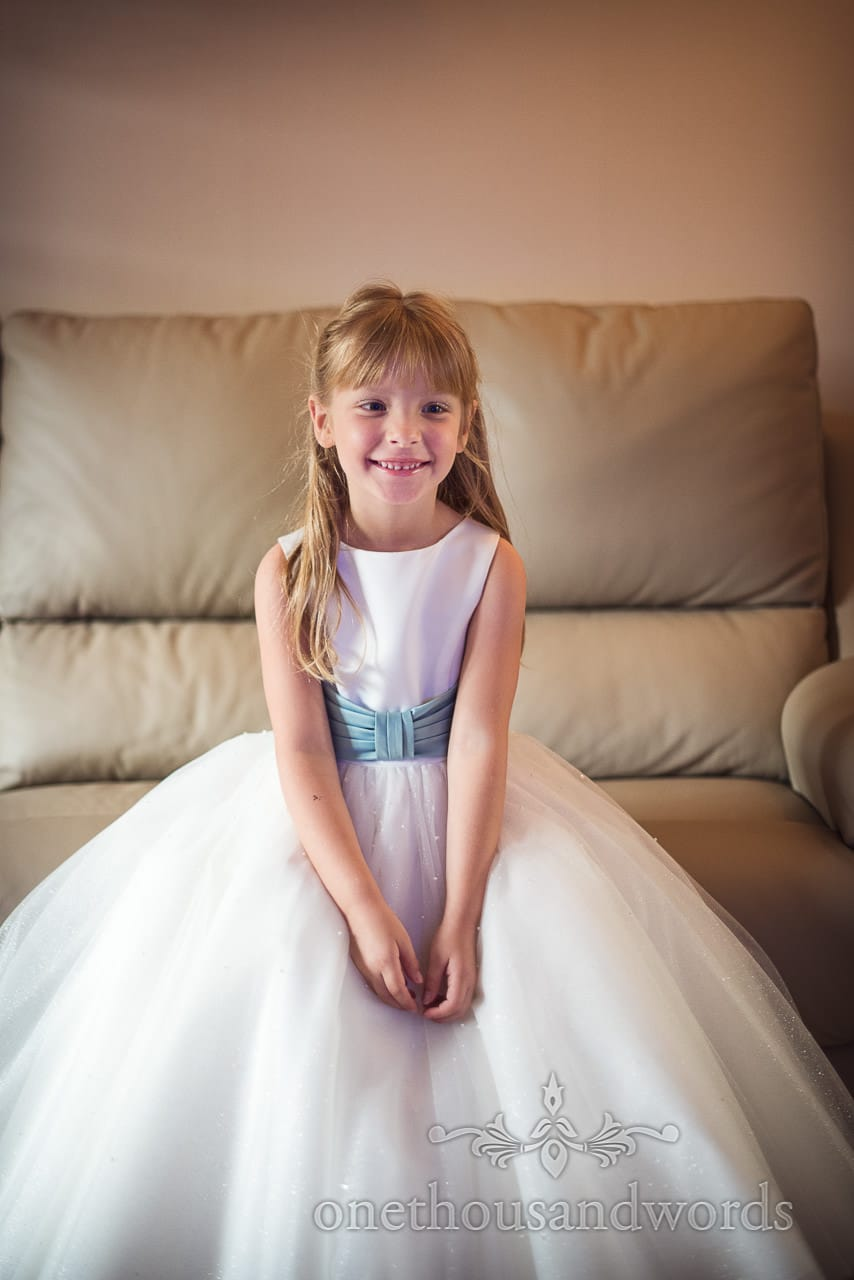 Smiling flower girl from morning of Canford School Wedding