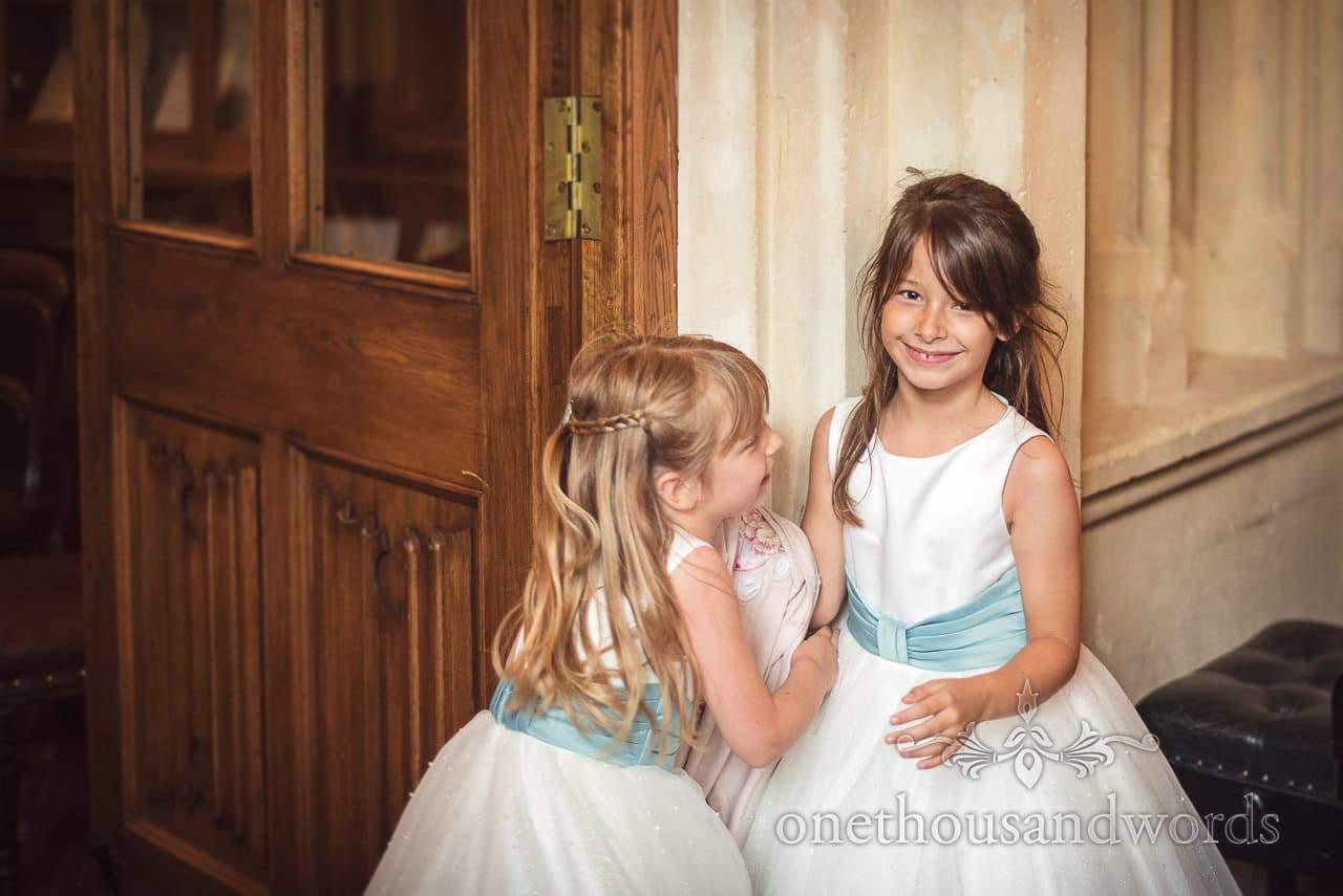 Smiling flower girls during Canford School Wedding