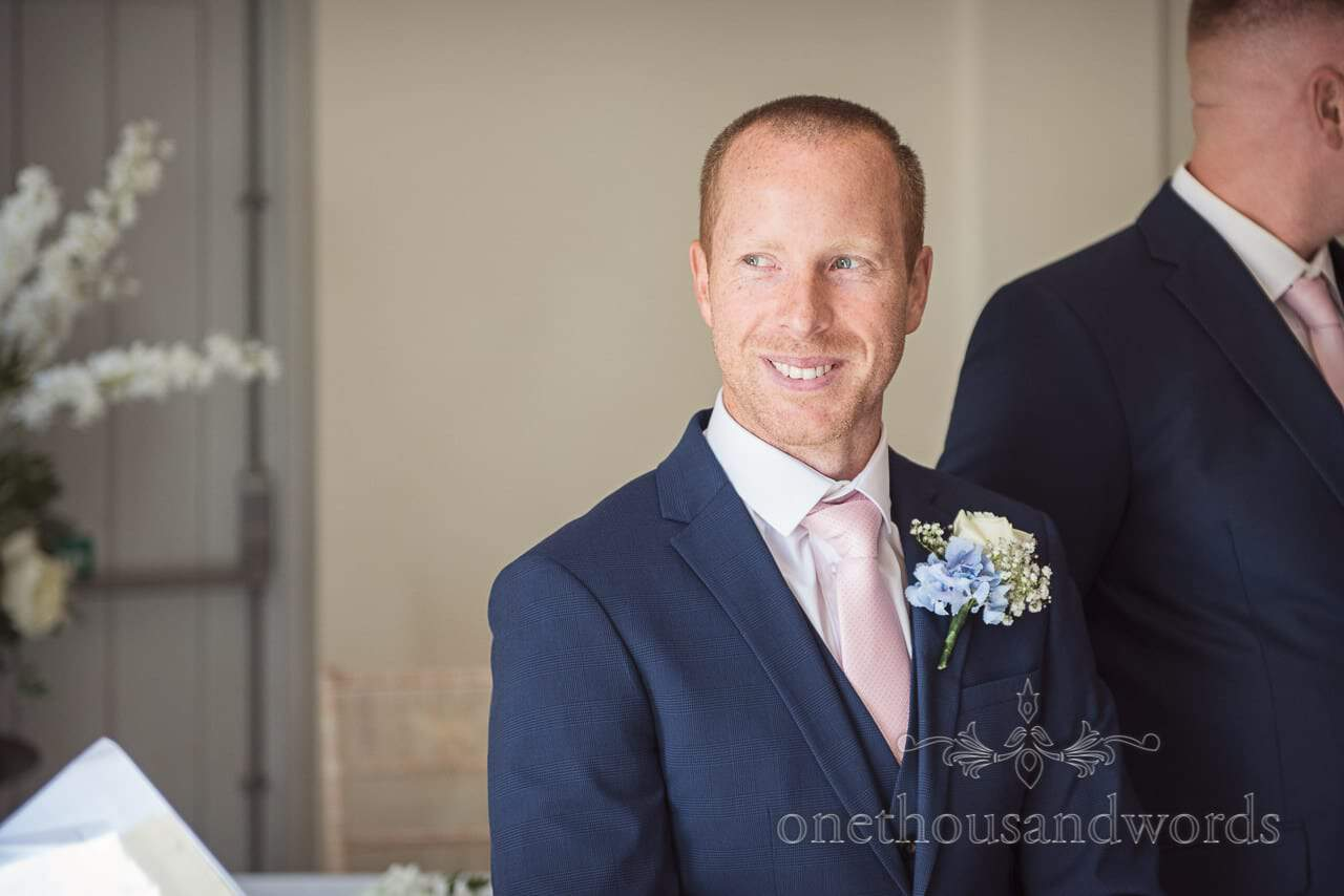 Smiling groom in blue suit during ceremony at Italian Villa Wedding