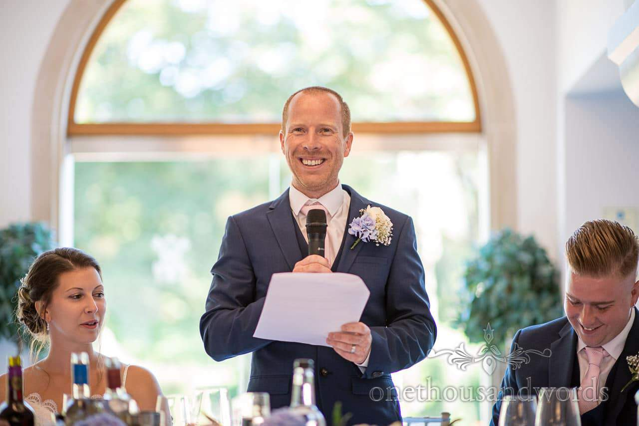 Smiling groom during delivery of speech at Italian Villa Wedding