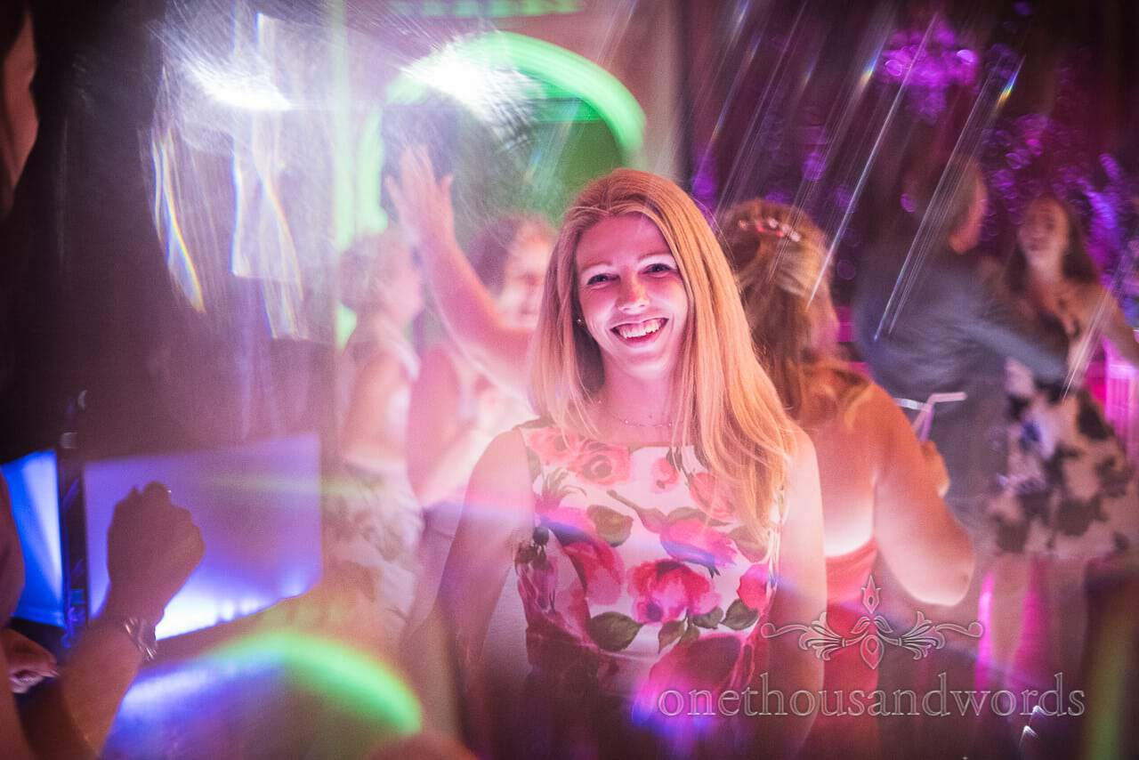 Smiling guest on the dance floor at Canford School Wedding Photographs