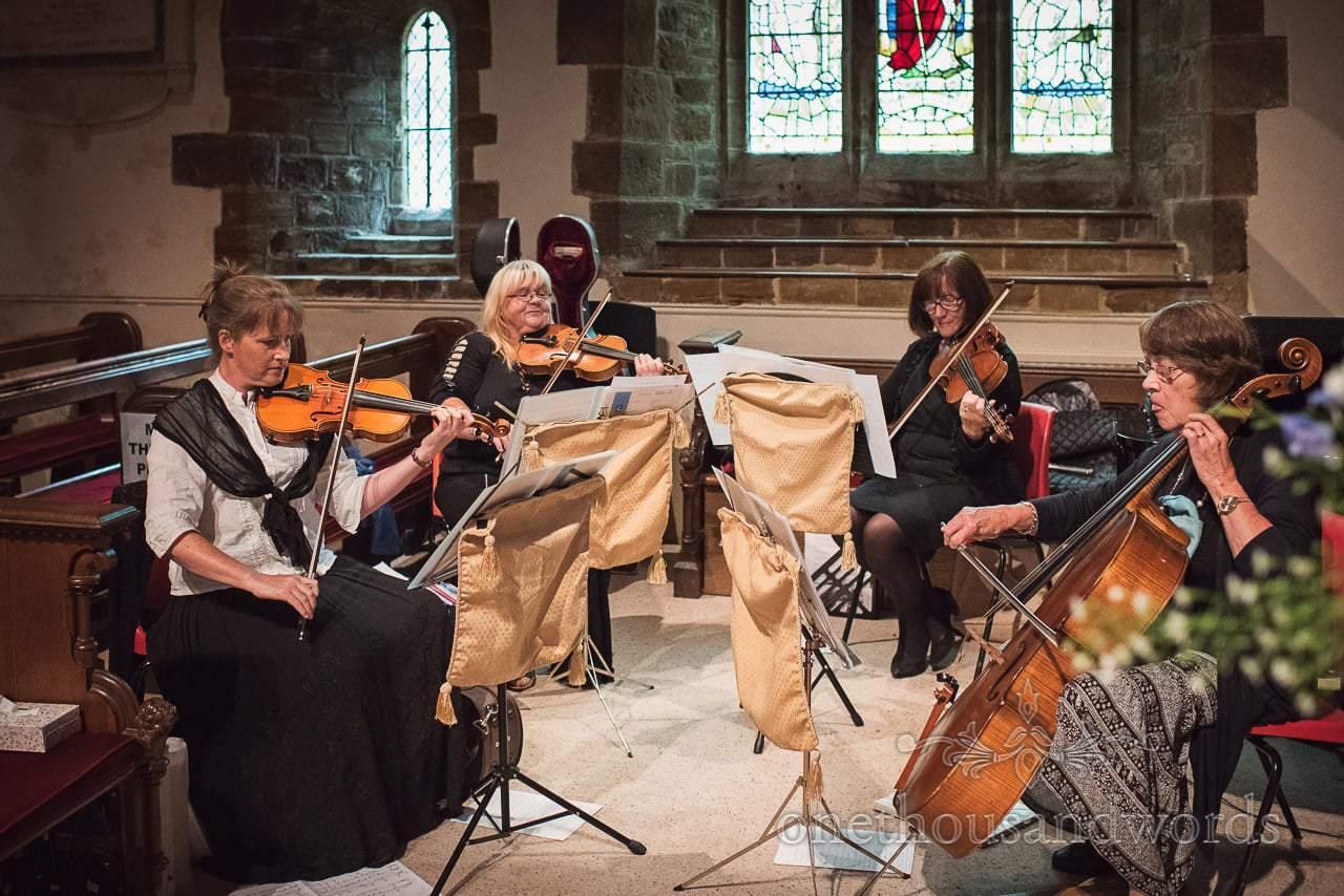 String quartet entertain guest before Canford School Wedding