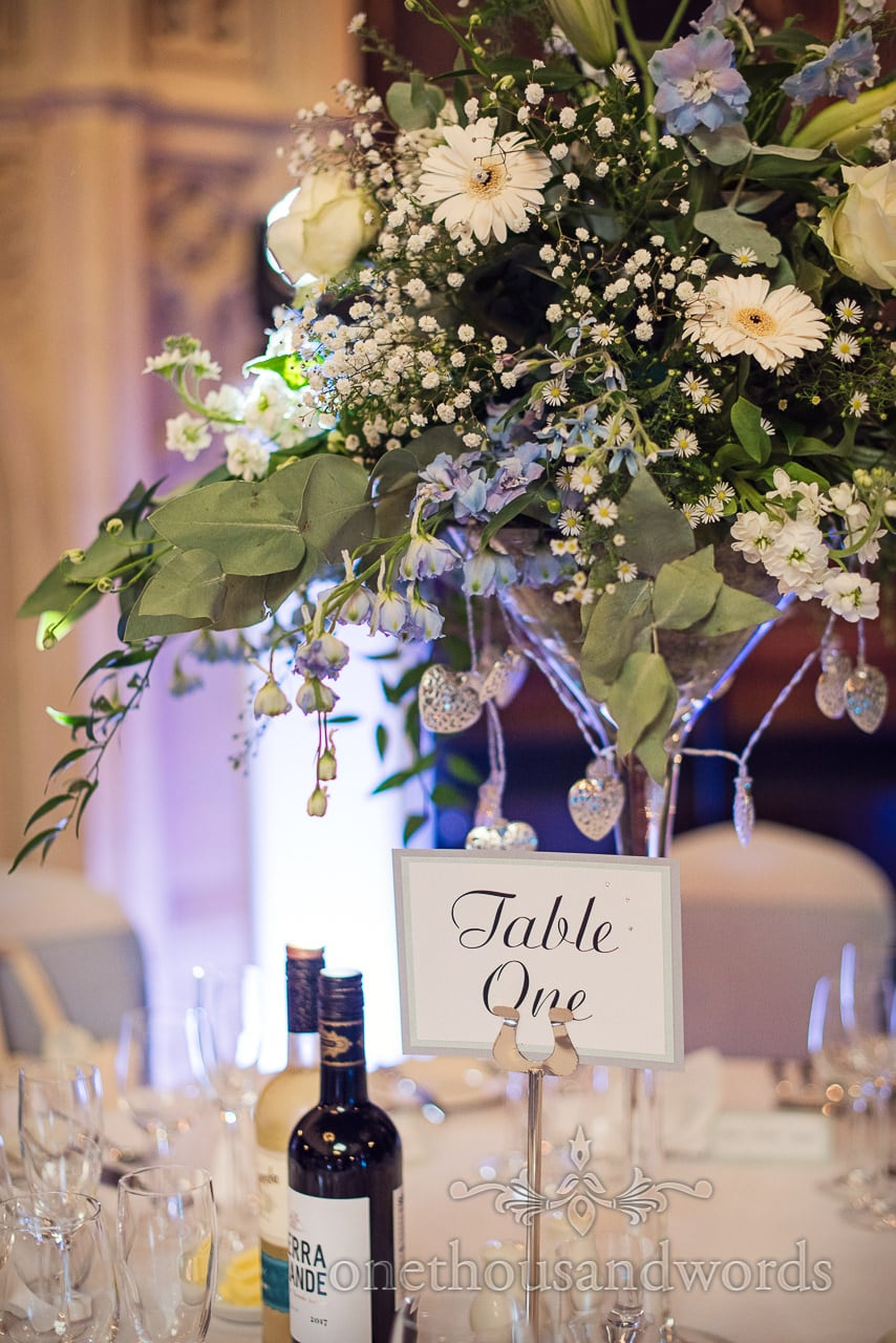 Table number below floral centerpiece at Canford School Wedding