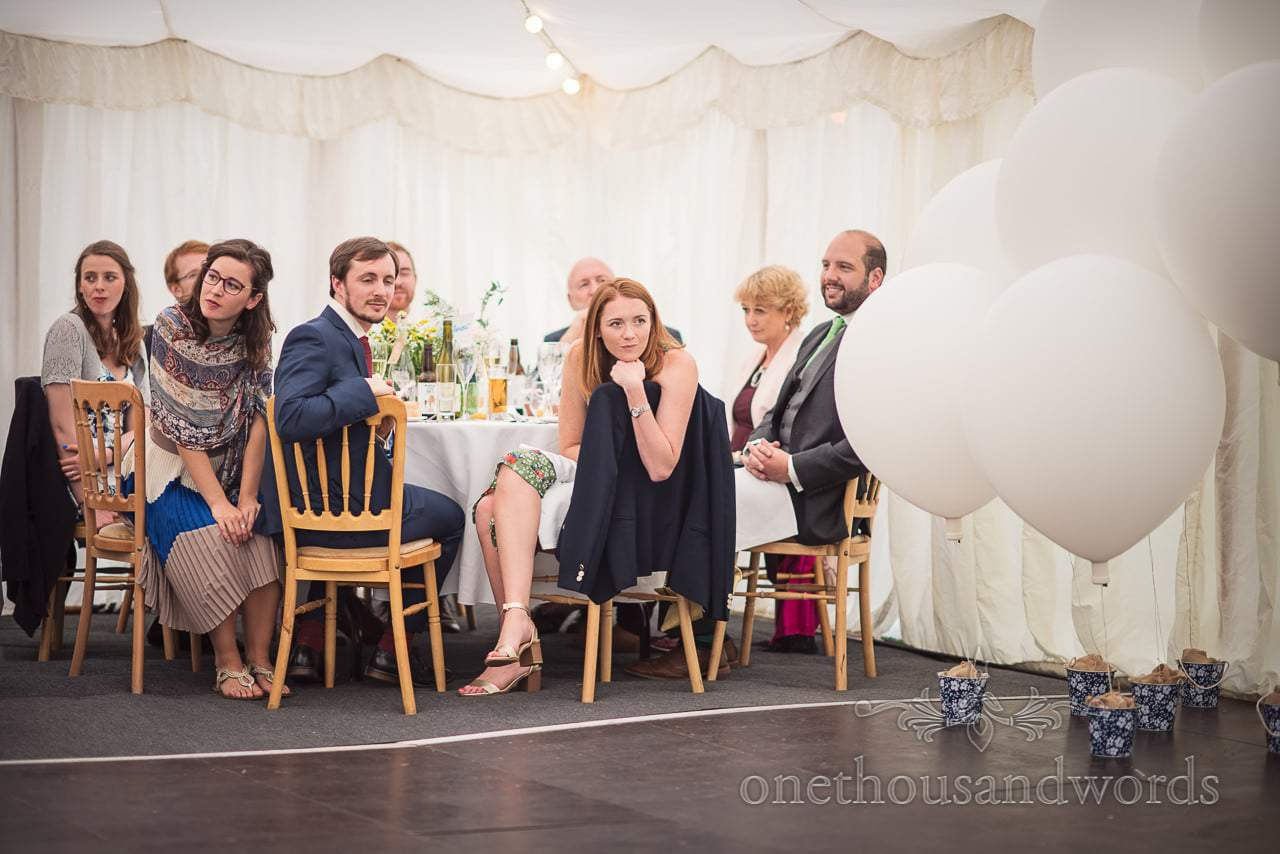 Table of wedding guests during speeches at Dorset garden wedding