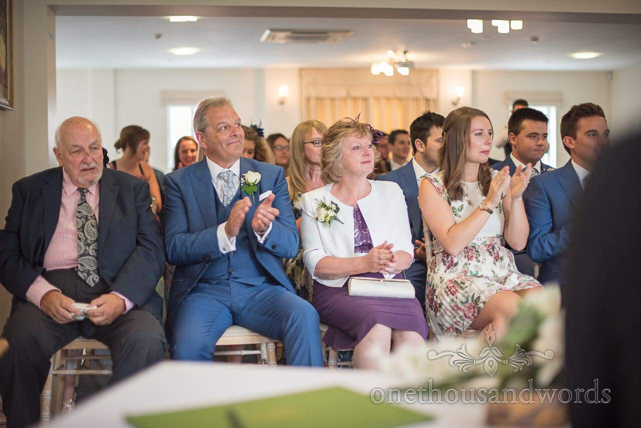 Teary eyed guests applaud during ceremony at the Italian Villa Wedding venue