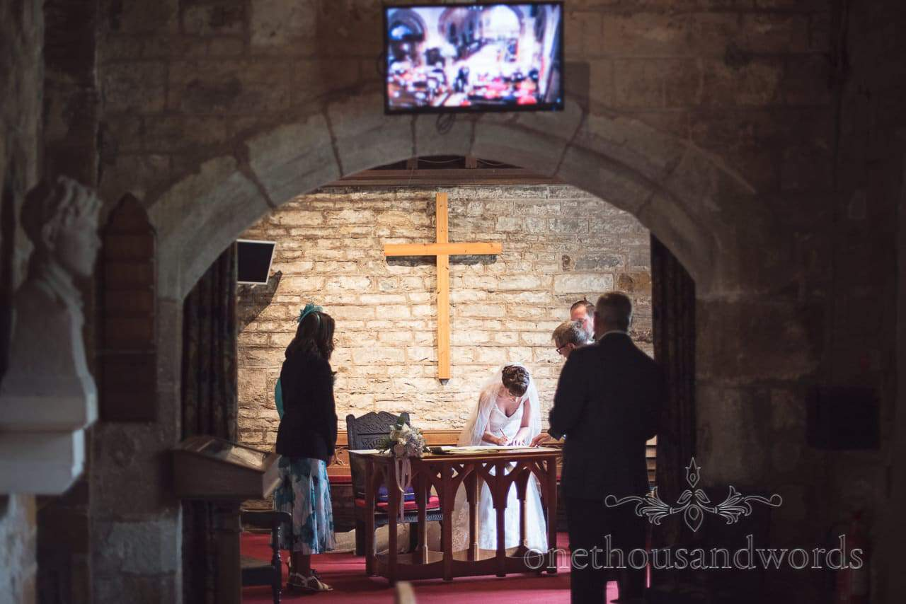 The signing of the register at Canford School Wedding Photographs