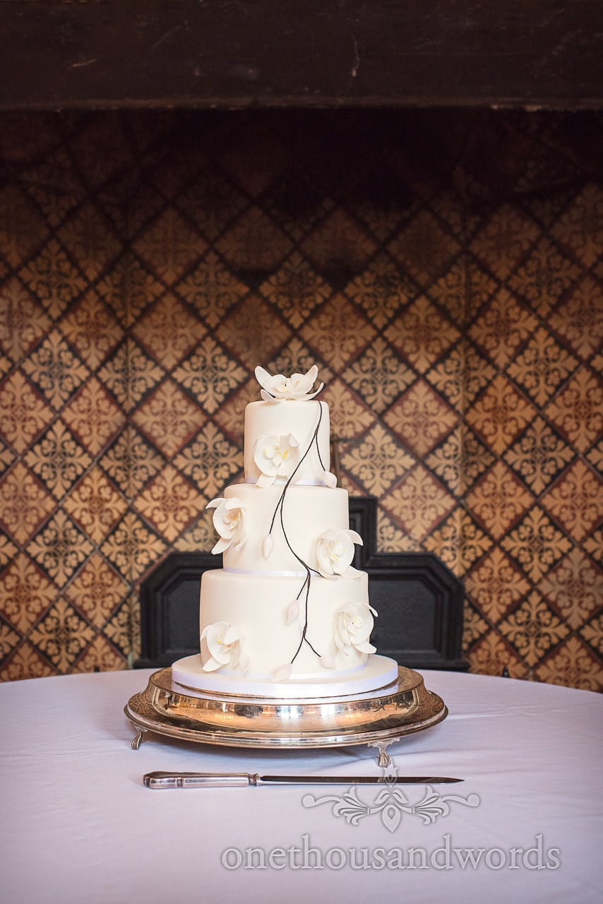 Three tiered wedding cake with flower details at Canford School Wedding