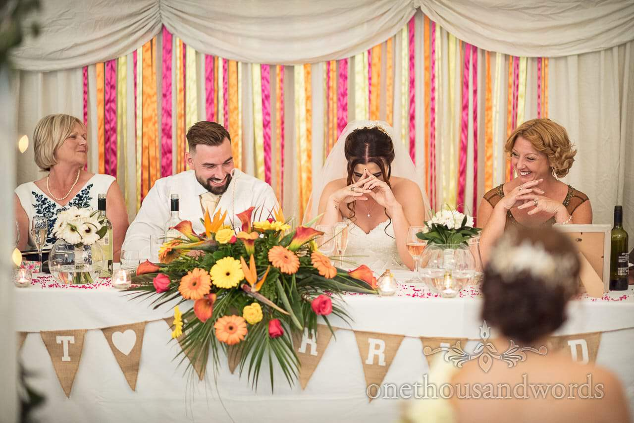 Top table reaction during speeches at The Old Vicarage Wedding Photographs