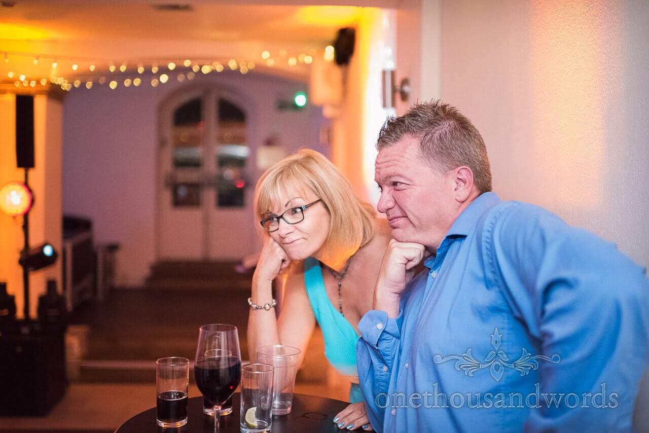 Unimpressed guests look on at dance floor at Italian Villa Wedding