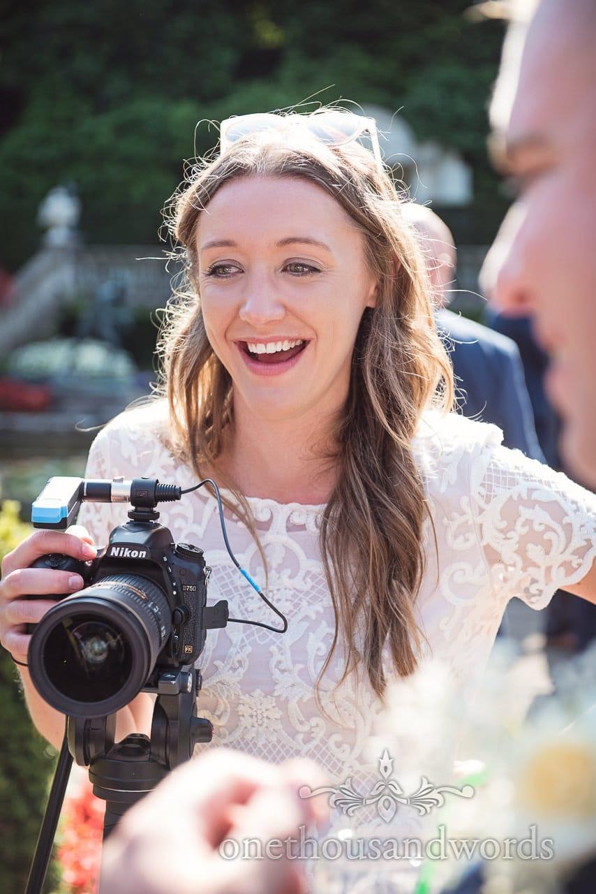 Videographer guest during garden reception at Italian Villa Wedding Photos