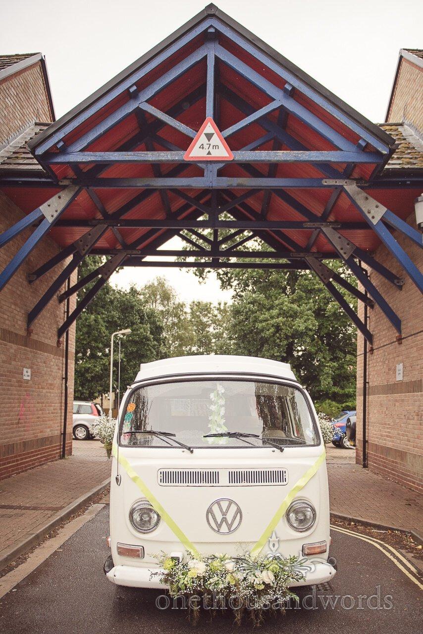 VW camper van with ribbon and flowers before Italian Villa Wedding