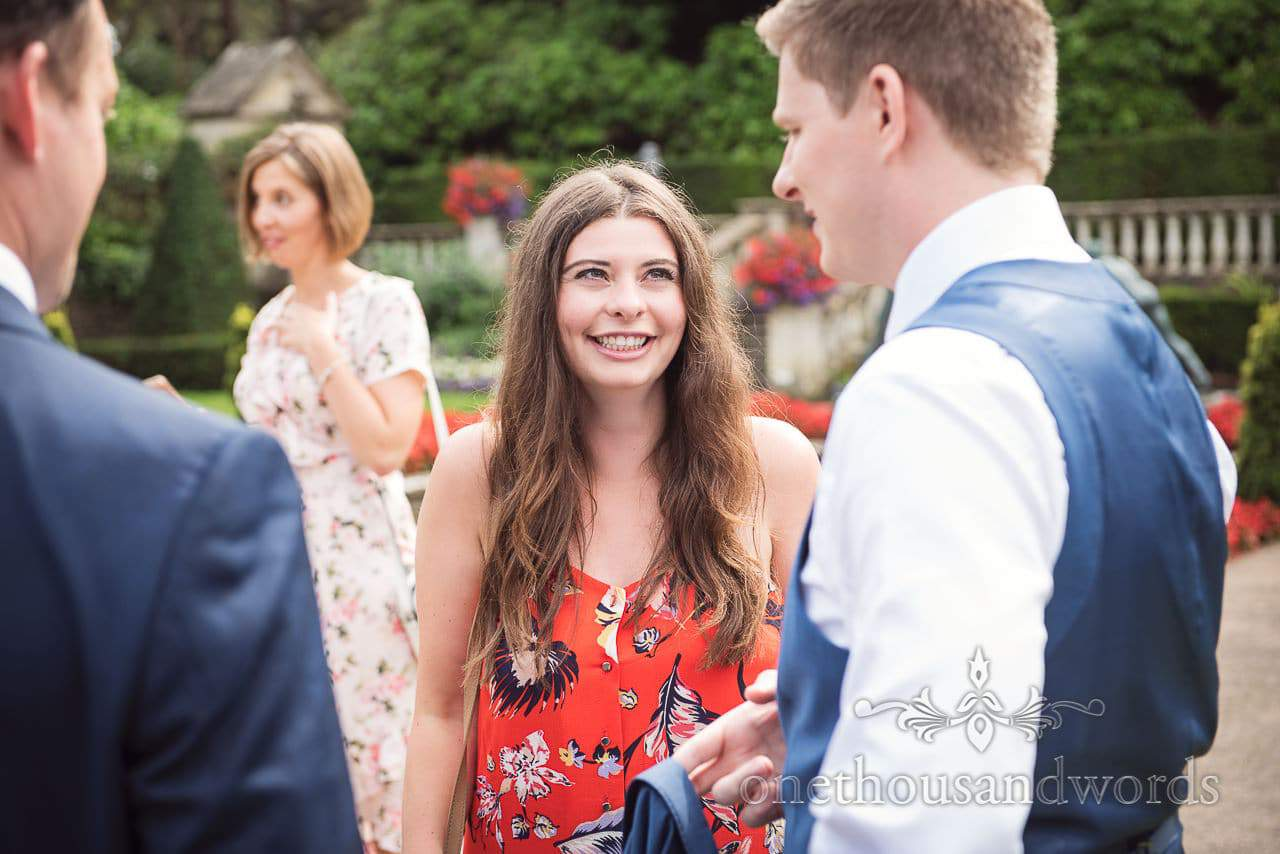 Wedding guest laughs with groom during Italian Villa wedding drinks reception