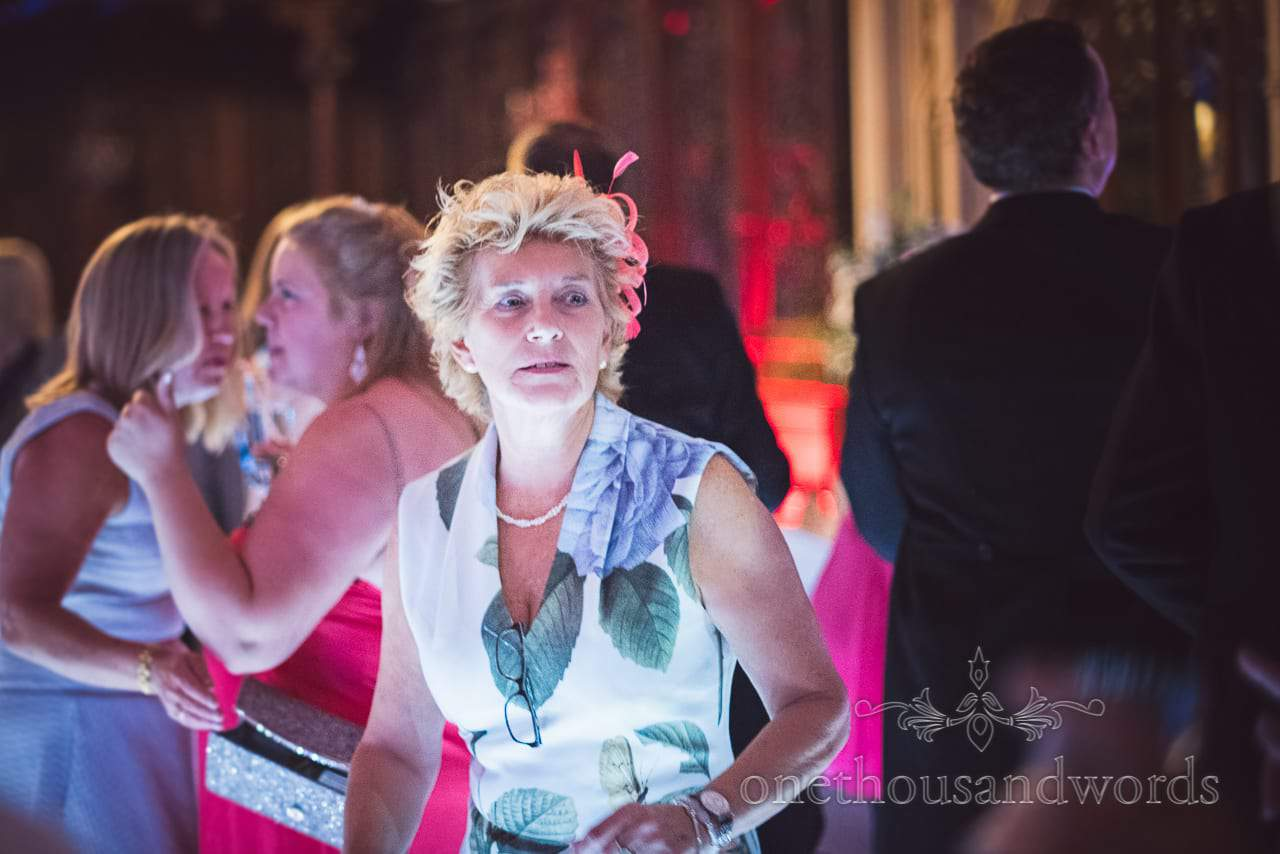 Wedding guest on dance floor during evening reception
