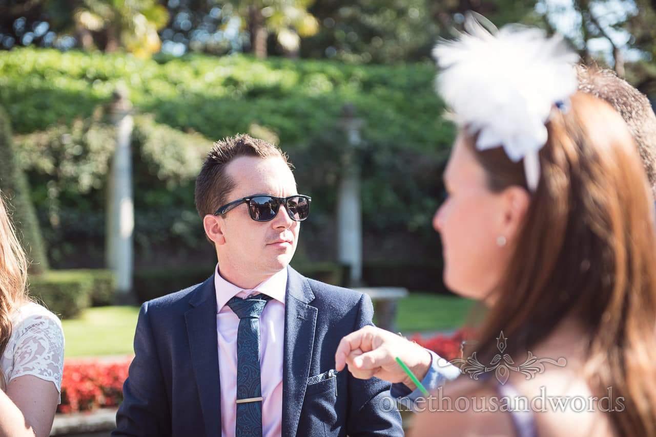 Wedding guest in sunglasses during reception at Italian Villa Wedding venue
