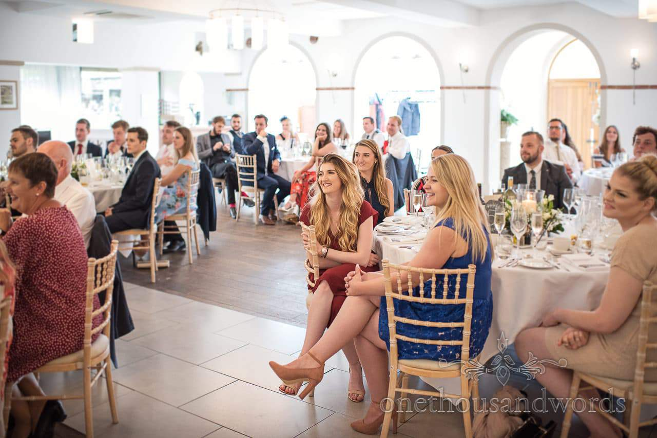 Wedding guests laughing during wedding speeches at The Italian Villa Wedding venue